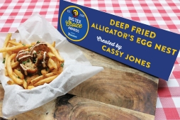 "Also making its Big Tex Choice Awards debut this year, alligator throws a whole new flavor into the mix. Giving fairgoers the true Cajun experience without having to travel all the way to the swamplands, the Deep Fried Alligator's Egg Nest blends rich alligator meat with Monterey Jack cheese, chopped jalapeños, onions and garlic. This flavorful mixture is then rolled in bread crumbs and deep fried to the perfect golden brown. Served atop a ""nest"" of shoestring potatoes and drizzled with a chipotle sauce, this dish will make you feel like a real ragin' Cajun!"