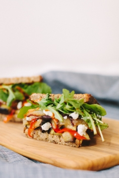 Eggplant Goat - A vegetarian sandwich that even the most unapologetic carnivore will adore, with roasted eggplant, charred onion, red bell pepper, goat cheese and spicy harissa tahini.