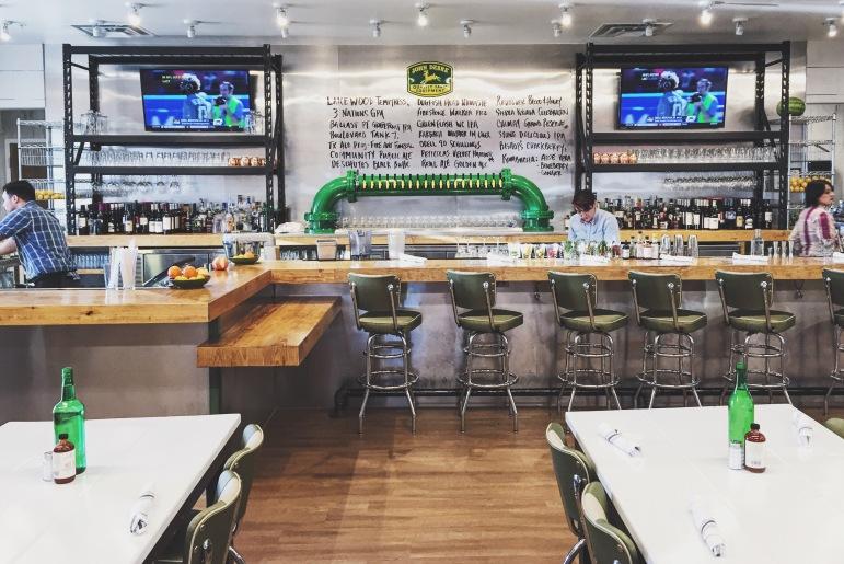 Grab a seat at the John Deere influenced bar.