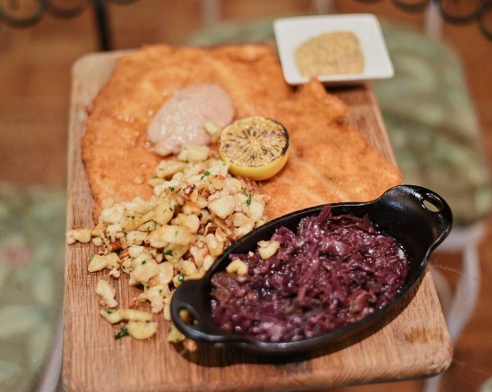The Big-As-Yo-Face Pork Schnitzel - the unofficial name, of course, was tender and lemony, served with spaetzel, cabbage, and housemate mustard.