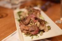 The Ribeye with turnip potato salad and grilled cipollini onion.