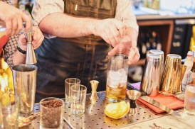 Master behind the bar, Mike Sturdivant, stirs up one of many new seasonal cocktails!