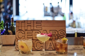An assortment of inventive and adventurous new cocktails: Peat and Peaches, Ten Minutes 'Til Midnight, and Green Eggs and Hami.