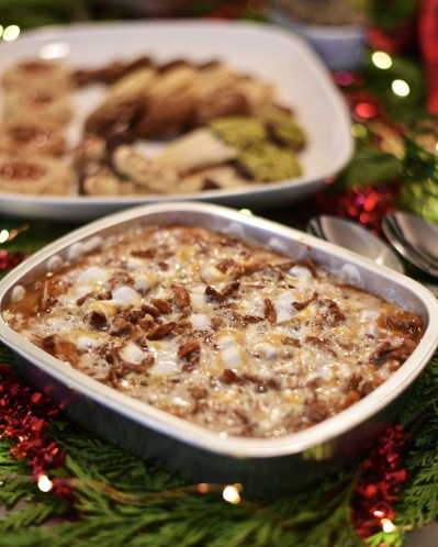 Smashed Sweet Potatoes: A rich and creamy puree of sweet potatoes and spices. Topped with brown butter caramel, crisp pecans and fluffy marshmallows.